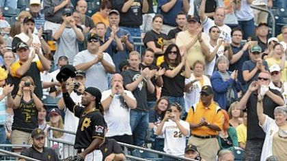 Pirates fans give center fielder Andrew McCutchen a standing ovation as he makes his way to the dugout during Wednesday&#039;s loss to the Braves.  n Visit post-gazette.com for video of fan reaction to the Pirates season.
