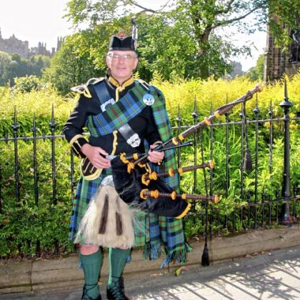 Bagpiper Neil MacLure wearing MacLure tartan.