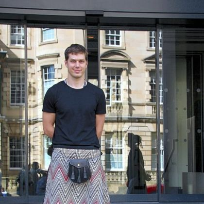 Balazs Kiss, in a Missoni print kilt outside of the Missoni Hotel in the Old City of Edinburgh.