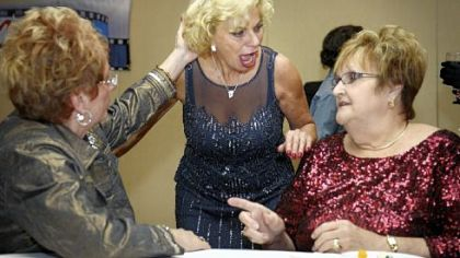 "Maria Rubino, center, greets Nancy Marocco, left, and Anita Cerri Wednesday at the premiere of ""Coiffure and Quips"" at the DoubleTree by Hilton Hotel Pittsburgh Airport in Moon."