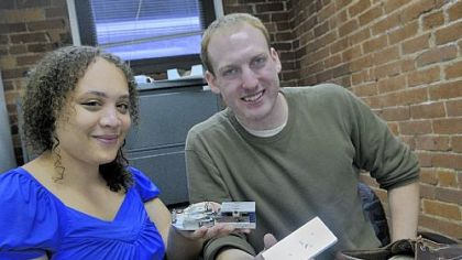 Hahna Alexander and Matt Stanton display their project, Sole Power, which charges a cell phone by walking.