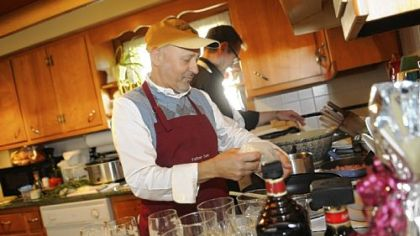 The Rev. Sam Esposito, of St. John the Baptist Parish, prepares risotto for a dinner for the Robino family in Monaca after they won his services in a benefit auction. Helping him is his sous chef, Mike Matta.