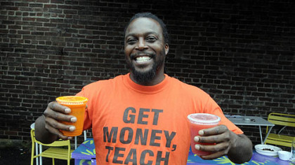 "Knowledge Huson of Juice Up 412 shows off the product during the first ""Good Truck Friday"" in the Strip District."