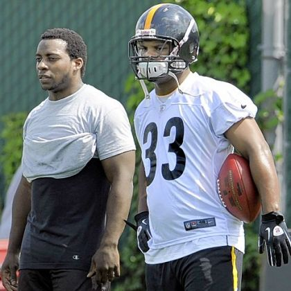 The pressure is on Isaac Redman, right, and Rashard Mendenhall to help the Steelers develop a balanced offense -- something they haven't had this season.