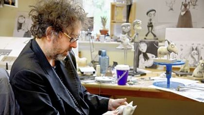 "Director/producer Tim Burton studies a model of Sparky during the making of ""Frankenweenie."""