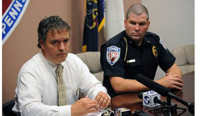 Washington, Pa., Police Lt. Dan Stanek, left, and Police Chief Robert Lemons, right, talk to the media.
