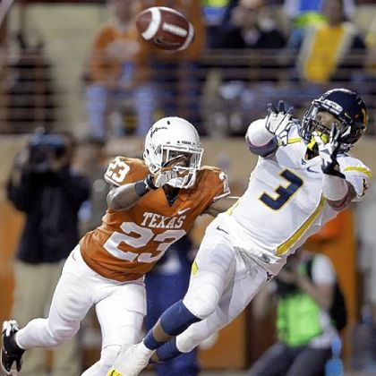 West Virginia's Stedman Bailey leaps for a touchdown pass as Texas' Carrington Byndom defends during the third quarter.