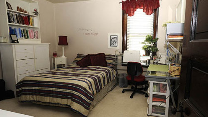 The bedroom is used as a combination guest room and sewing room.