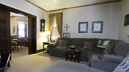 The living room and dining room can be separated by oak pocket doors.