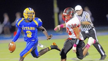 West Mifflin quarterback Derrick Fulmore runs against Elizabeth Forward's Anthony Hill Friday at West Mifflin High School