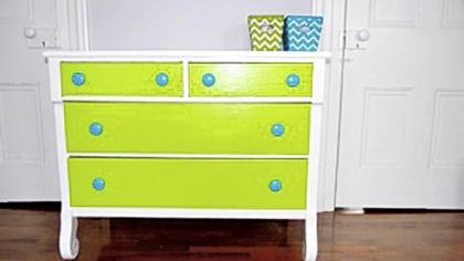 Hand-painted dresser by Melissa and Pamela Brusoski sports a crisp, white body and top, lime green drawer fronts and turquoise drawer pulls.
