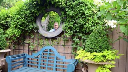 Ron Kotcho in the Squirrel Hill garden he designed.