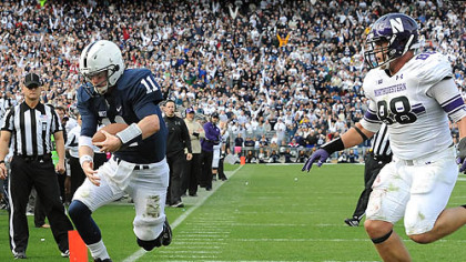Penn State quarterback Matt McGloin leaps in to the end zone scoring the game-winning touchdown against Northwestern in today's game at State College.