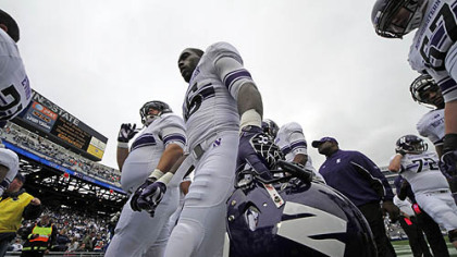 The Northwestern football team heads to the locker room after warming up before today's game against Penn State in State College.