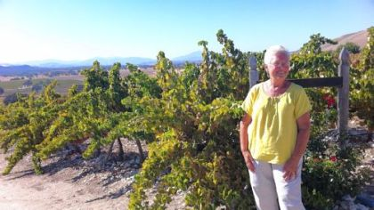 Paula Getzelman stands by the vineyard she and her husband planted a decade ago beside their home near Lockwood, Calif. She is one of several southern Monterey County residents concerned that shale drilling in the region could jeopardize the region's burgeoning wine industry.
