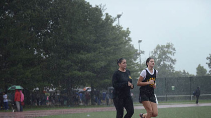 Pittsburgh Police Officer Colleen Bristow runs with her daughter, Laurel, 12, after her track meet Thursday in Schenley Park. Officer Bristow was injured in an on-the-job incident on the North Side in September 2010.  Until recently, running was made impossible by her injuries.