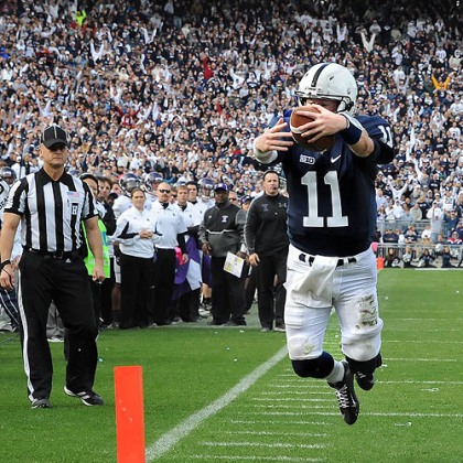 Penn State quarterback Matt McGloin leaps into the end zone scoring the game-winning touchdown against Northwestern in today's game at State College.