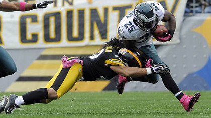 Troy Polamalu takes down Eagles' LeSean McCoy in the first quarter Sunday at Heinz Field.