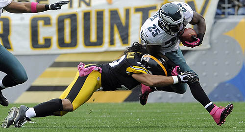 Tomlin: Polamalu, Woodley unlikely to play Thursday