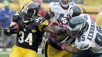 Rashard Mendenhall pushes away from the Eagles' Mychal Kendricks in the third quarter Sunday at Heinz Field.
