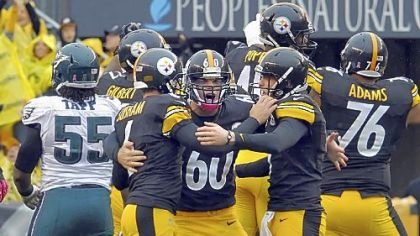 Shaun Suisham is congratulated by teammates Greg Warren and Drew Butler after kicking the winning field goal against the Eagles in the fourth quarter Sunday at Heinz Field.