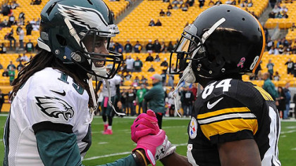 The Eagles&#039; Mardy Gilyard greets the Steelers&#039; Antonio Brown prior to the game.