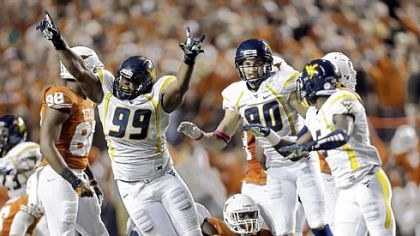 Desmond Jackson (99) and West Virginia stopped Texas when it mattered most Saturday in Austin, Texas.