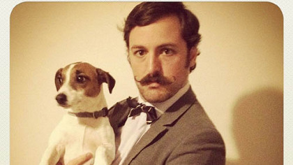 Adam Causgrove, 28, of Mount Washington, with Oliver, is a finalist for the Robert Goulet Memorial Mustached American of the Year award.