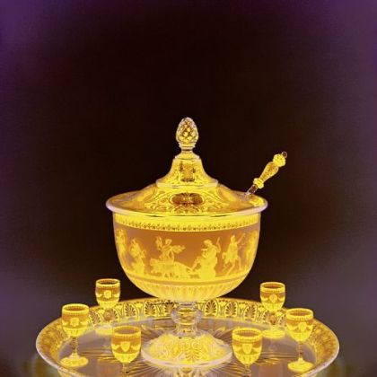 Baccarat exhibited this lidded punch bowl with goblets, tray and ladle, made around 1867, at the Paris world's fair that year. Made in the neo-Grecian style, the scene on the bowl was made with acid etching.