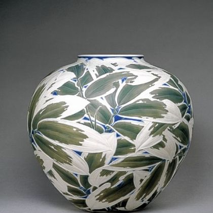 Itaya Hazan's training as a sculptor is clear in this carved porcelain vase that Henry Walters bought at the 1915 Panama-Pacific International Exposition held in San Francisco. Hazan's shallow relief of overlapping bamboo leaves are heightened by dark green and blue stains with a pure white matte finish.