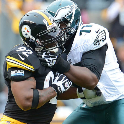 Steelers James Harrison battles with Eagles tackle Demetress Bell in Sunday's game at Heinz Field. At one point in the game Harrison pulled up rather than hit Michael Vick because of previous fines from the league.