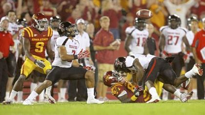 Texas Tech safety D.J. Johnson, right, breaks up a pass intended for Iowa State&#039;s Ernst Brun Jr., allowing teammate Cornelius Douglas, left, to move in for the interception in a game earlier this season. Texas Tech is No. 1 in NCAA Division I-A in pass defense and No. 2 overall.
