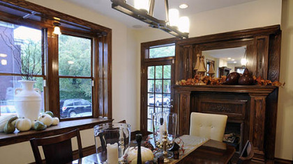 The dining room in Mark and Mary Pent&#039;s Shadyside home. Juniper Holdings custom-built the fireplace mantel.