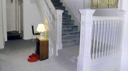The oak staircase of Ty and Sue Ely's home in Shadyside was painted white when they bought it.