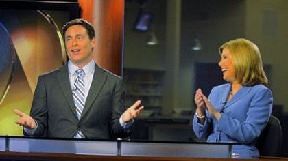 Todd McDermott, seen here in a 2011 photo, talks to a floor person, as WPXI co-anchor Jennifer Abney reacts.