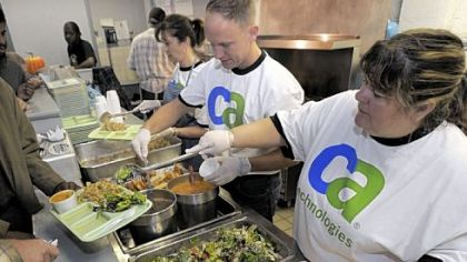 From right, Sue Mangus, Jim Kodoszyunski and Karen Joseph, volunteers from CA Technologies, spend their volunteer day Wednesday serving meals at the Jubilee Kitchen, Uptown. It was the company's seventh annual day of volunteer action.