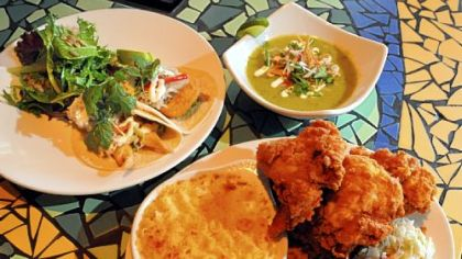 Clockwise from left, executive chef Benjamin Sloan's fish tacos, avocado soup and fried chicken with sides at Kaya in the Strip District.