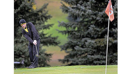 John McCabe competes in a golf tournament Monday for North Allegheny High School at the Hiland Golf Course in Butler.