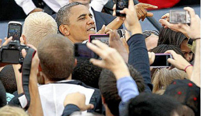 President Barack Obama greets supporters at the University of Iowa in Iowa City on Friday.