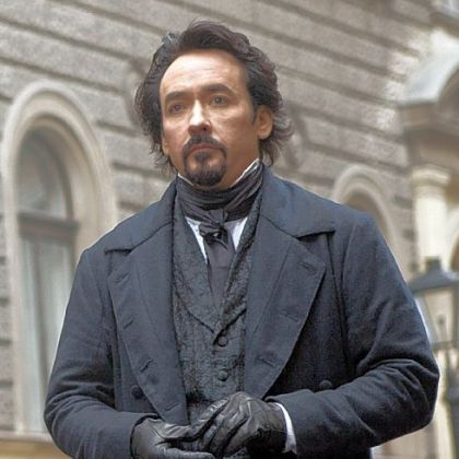 "John Cusack portrays Edgar Allan Poe in ""The Raven."""