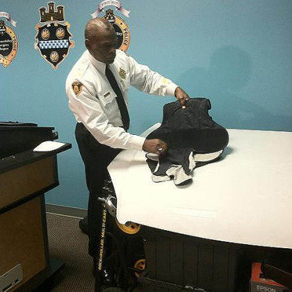 Pittsburgh Police Chief Nate Harper shows the bullet-resistant vest Officer Andrew Baker was wearing, and where the bullet struck: In the center of Officer Baker's chest.