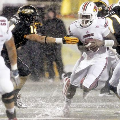 Louisville quarterback Teddy Bridgewater pulls away from Southern Miss linebacker Terrick Wright in a game No. 19 Louisville won, 21-17.