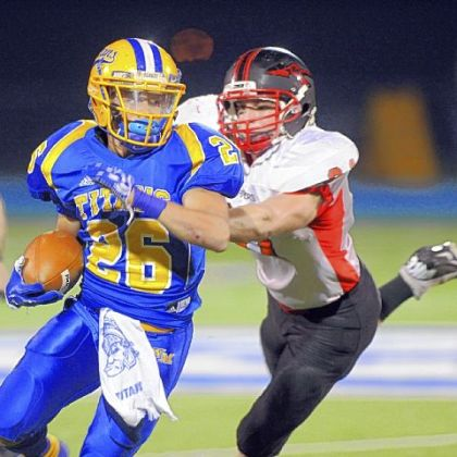 West Mifflin running back Jimmy Wheeler rushes against Elizabeth Forward in the first quarter last Friday.