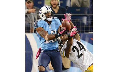 The Titans Kenny Britt makes catch in the end zone over Ike Taylor.