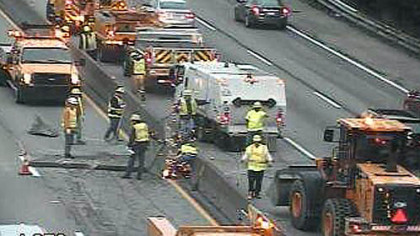 A PennDOT camera shows crews just after sunrise working to clear the crash scene on the Parkway West.