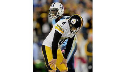 Steelers kicker Shaun Suisham hangs his head after missing a potential game winning field goal against the Titans last night in Nashville.