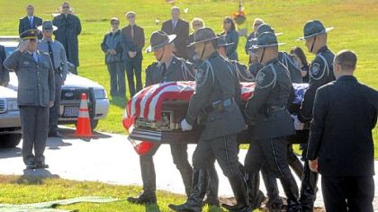 Troopers carry the casket of Trooper First Class Blake T. Coble to the graveside ceremony at St. Mary's Roman Catholic Church Cemetery in Beaver Falls.