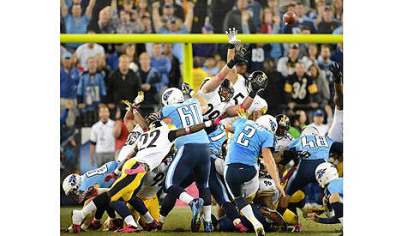 Titans kicker Rob Bironas hits the winning field goal for Tennessee over the Steelers as time expires last night in Nashville.