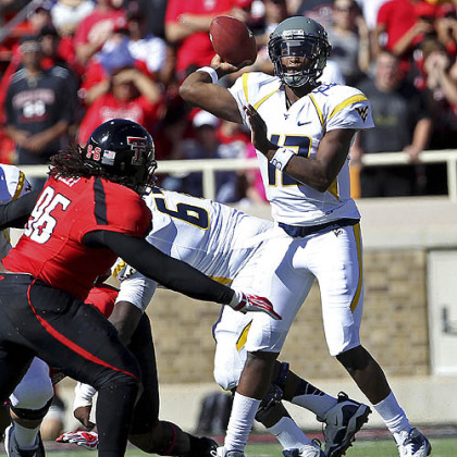 West Virginia's Geno Smith throws under pressure from Texas Tech's Dennell Wesley.