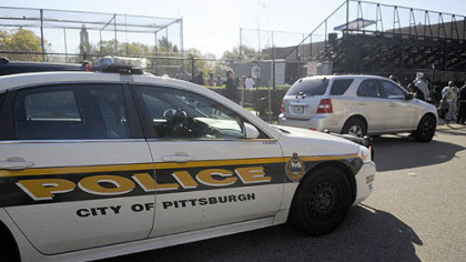 Pittsburgh police at the scene of a shooting before a peewee football game this morning adjacent to the Pittsburgh Obama International Studies Academy in East Liberty.